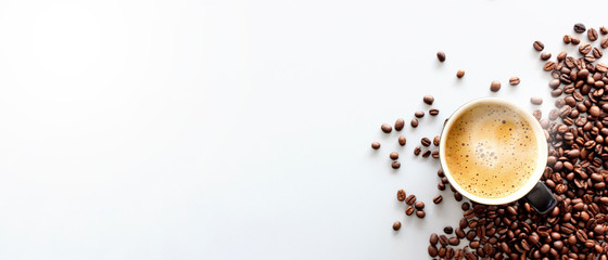 hot espresso and coffee bean on white table with soft-focus and over light in the background. top view Wall mural