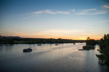 View over boats at Colorado river at sunset, Texas.