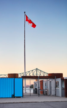 The gate door of the old port Montreal Canada. Canada flag is waving at the top.