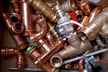 Small material for plumbers and heating installers. Copper, brass, steel, pipes, angles.