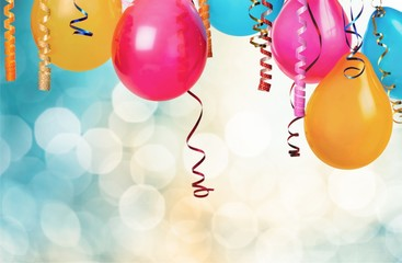 Bunch of colorful balloons on bokeh background