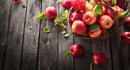 Fresh Red Apples With Green Leaves On A Wooden  Background