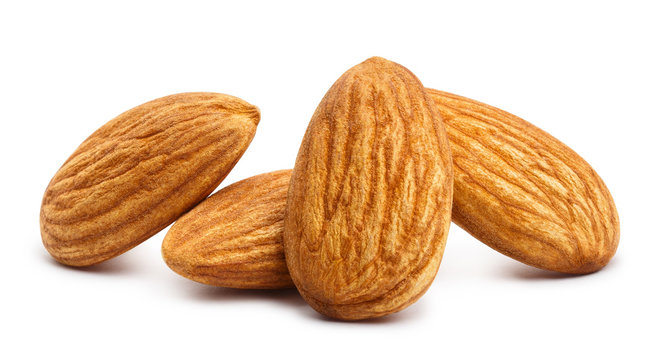Close-up of almonds, isolated on white background