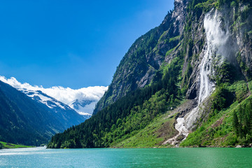 Wall Mural - Nature landscape scenery view of a waterfall in Austria, located in the idyllic Zillertal Alps Nature Park