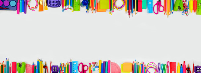 School supplies double border banner. Top view on a white background with copy space. Back to school concept.
