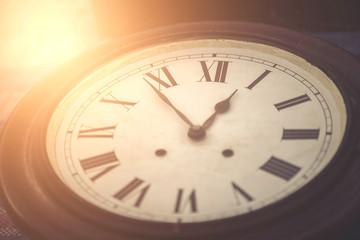 Old vintage clock set time 12.54 pm