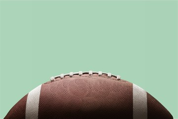 American football ball on background