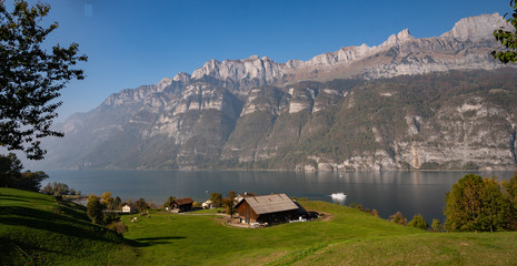 rural view on Walensee lake in Switzerland surounded by mountains