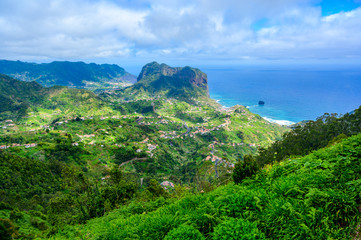 Foto auf Gartenposter Grun Landscape scenery from Portela Viewpoint - Porto da Cruz at beautiful coast and mountains in the north of Madeira island - Ribeira Frio-Portela, Portugal.