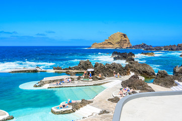 Natural volcanic swimming lagoon pools at Porto Moniz, travel destination for vacation, Madeira island, Portugal Fototapete