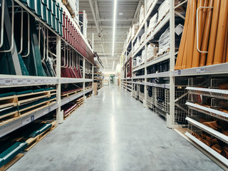 Store for home improvement and DIY. Warehouse aisle of building materials in industiral store. Shallow DOF