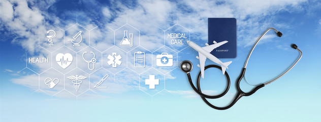 international medical travel insurance concept, stethoscope, passport and airplane, with icons and symbols isolated on white background