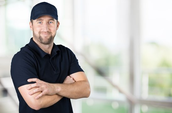 Handsome delivery man isolated on light background