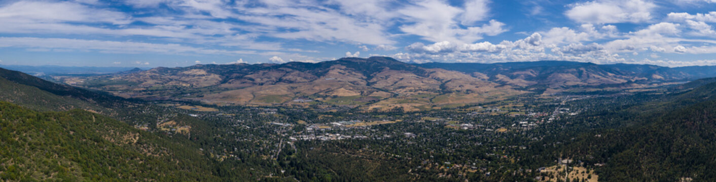 Seen from a bird's eye view forest covers the hills surrounding Ashland, a quaint city in southern Oregon. This area is known for mountain biking and the Oregon Shakespeare Festival.