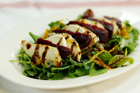 compound salad with chicken goats cheese and beetroot