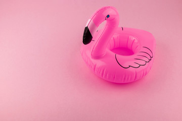 Giant inflatable Flamingo on a pink background, pool float party, trendy summer minimal concept with Clipping Path.