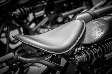 Black and white image of vintage motorbike closeup