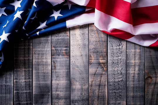 Top view of Flag of the United States of America on wooden background.  Independence Day USA, Memorial.