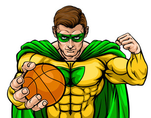 A superhero basketball sports mascot holding a ball