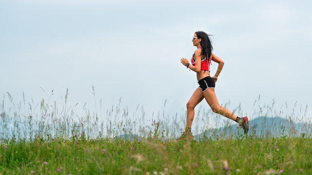 Woman runner during the preparation of a long distance trail