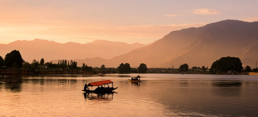Shikara boats on Dal Lake with Sunset Dal Lake in Srinagar Jammu and Kashmir state India
