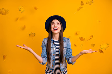 Portrait of her she nice charming attractive lovely careless optimistic cheerful cheery straight-haired lady throwing seasonal leaves having fun isolated over bright vivid shine yellow background Wall mural
