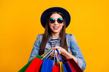 Portrait of charming cute funny teen teenager astonished impressed reaction scream shot unbelievable unexpected summer retail cheerful content denim jeans striped clothes isolated yellow background