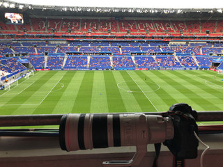 A camera rests on the railing in a photographer tribune position before the U.S.-England match during the Women's World Cup soccer tournament in Lyon