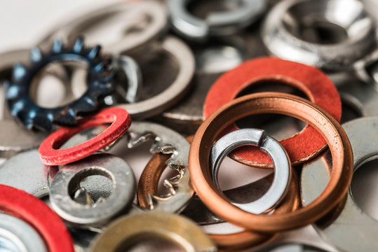 Divers industrial washers and rings. Various colorful washers rings on white background Screw washer.