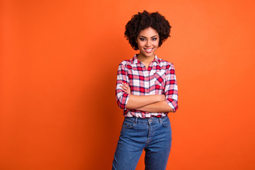 Portrait of her she nice-looking attractive winsome lovely cheerful cheery wavy-haired lady wearing checked shirt folded arms good day isolated on bright vivid shine orange background