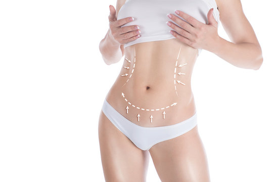 Female slim body in base underwear. Lifting marking with arrows in womans belly and waist, isolated on white. Selective focus