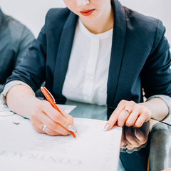 Legal deal. Partnership and cooperation. Cropped shot of successful business woman signing contract.