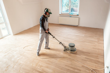 Obraz professional floor master with polishing machine - fototapety do salonu