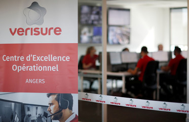 Help desk staff work on their computers as they support alarm triggers in private homes or small business at the hub of Verisure, a provider of professionally monitored security solutions, in Angers