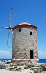 A medieval stone windmill at Mandraki harbour in Rhodes Old Town on the Greek island of Rhodes.