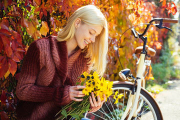 Woman with bicycle autumn garden. Weekend activity. Active leisure and lifestyle. Girl ride bicycle for fun. Blonde enjoy relax park garden. Autumn bouquet. Warm autumn. Girl with bicycle and flowers Fototapete