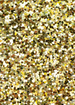 Shiny background with yellow glitter close up.