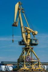 detailed yellow dockside crane at the industrial harbour in Rostock