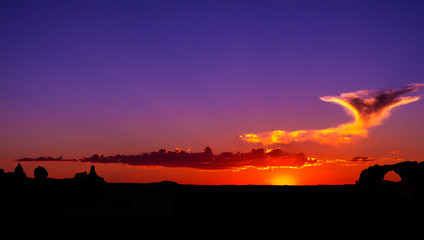 Colorful Desert Sunset In Arches National Park Moab Utah USA With Silhouette Arch and Sandstone Rock Formations