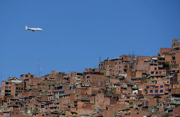 A plane is seen from Chua Uma, a neighbourhood that changed thanks to urban art, in La Paz