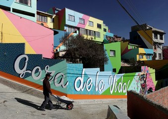 A man walks in Chua Uma, a neighbourhood that changed thanks to urban art, in La Paz