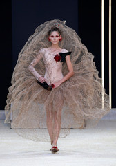 A model presents a creation by designer Guo Pei as part of her Haute Couture Fall/Winter 2019/20 collection show in Paris