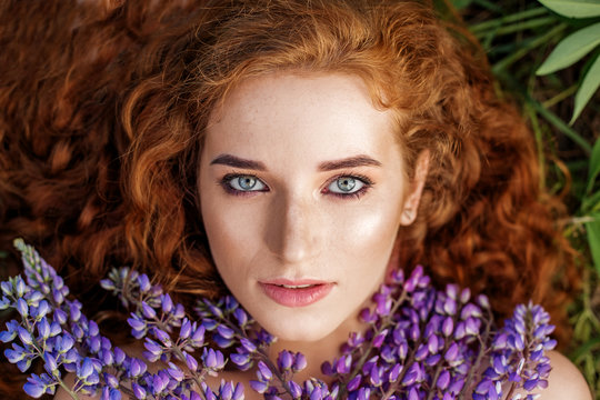 Female beauty portrait. Red-haired girl with healthy hair. The concept of fashion, beauty, cosmetics and care
