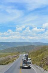 Papiers peints Amérique du Sud Car on the road among Andean mountains.