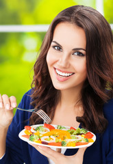 beautiful woman with plate of vegetarian vegetable salad