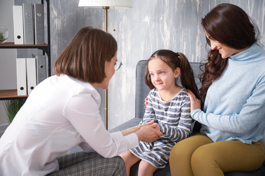 Female psychologist working with family in office
