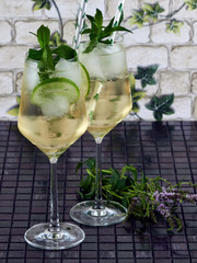 Hugo spritz (cocktail) served in tall white whine glasses