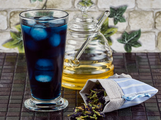 Honey sweetened blue butterfly pea flower (Clitoria ternatea) iced tea