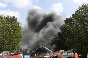 Fire fighters extinguish a fire at the Dong Xuan Center, an Asian shopping centre in Berlin