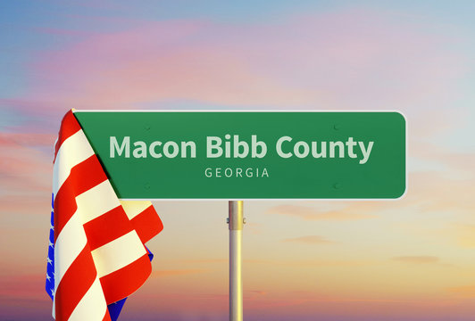 Macon Bibb County – Georgia. Road or Town Sign. Flag of the united states. Sunset oder Sunrise Sky